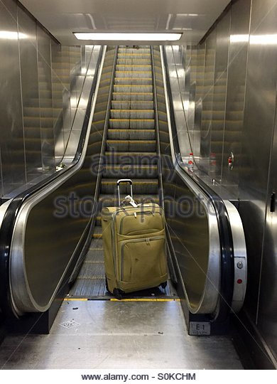 abandoned-luggage-on-escalator-may-be-a-security-threat-s0kchm